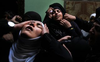 TOPSHOTSPalestinian relatives of Islamic Jihad militant Mohammed Daher, who was killed the night before along with another comrade in an Israeli air strike, mourn during his funeral in Gaza City on  March 13, 2012. Israel and militants in Gaza agreed to cease hostilities on March 13 after Egypt brokered a