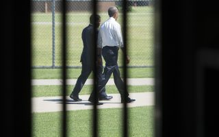 US President Barack Obama walks through the prison yard during a tour of the El Reno Federal Correctional Institution in El Reno, Oklahoma, July 16, 2015. Obama is the first sitting US President to visit a federal prison, in a push to reform one of the most expensive and crowded prison systems in the world. AFP PHOTO / SAUL LOEB