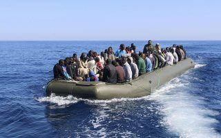Illegal migrants, who attempted to flee the coast to Europe, travel in a boat after they were detained by the Libyan coastguard in Garbouli June 5, 2014. Libya's coastguard picked up over 100 immigrants in its waters to the west of Tripoli on Thursday, Libyan coast guards officials said. The 114 men, mostly from Senegal, were detained as they were trying to cross to Europe in a small boat.  REUTERS/Hani Amara (LIBYA - Tags: SOCIETY IMMIGRATION CIVIL UNREST CRIME LAW MARITIME)