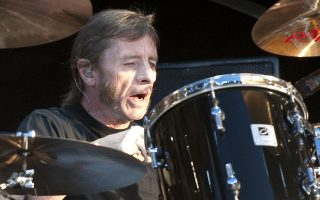 DERBY, UNITED KINGDOM - JUNE 11: Phil Rudd of AC/DC performs on stage on the first day of the Download Festival at Donington Park on June 11, 2010 in Derby, England. (Photo by Neil Lupin/Redferns)