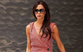 Victoria Beckham makes a statement in a coral colored dress while exiting an art gallery in the Chelsea neighborhood of NYC.<P><noscript><img width=