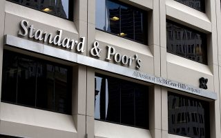 The Standard & Poor's Corp. sign is displayed outside of their headquarters in New York, U.S., on Friday, March 6, 2009. The S&P 500 is headed for its fourth straight weekly decline as the worsening recession, a third government rescue for Citigroup Inc. and dividend cuts at companies from General Electric Co. to JPMorgan Chase & Co. helped drag the measure down 25 percent this year. The index has fallen 8 percent this week. Photographer: Jin Lee/Bloomberg News