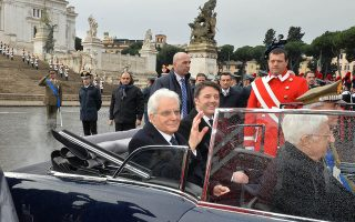 In this handout picture released by the Quirinale press office newly elected President, Sergio Mattarella (L) and Italian Prime Minister Matteo Renzi leave Piazza Venezia in the presidential car