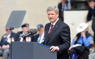 Stephen Harper, Canada's prime minister, speaks during the D-Day anniversary ceremony near the American cemetery in Colleville sur Mer, France, on Saturday, June 6, 2009. U.S. President Barack Obama, in France to commemorate the 65th anniversary of D-Day, paid tribute to the allied forces who landed at Normandy and endured ìunimaginable hellî to start the liberation of Europe. Photographer: Antoine Antoniol/Bloomberg News