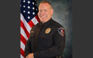 FILE- This undated file photo provided by the Arlington Police Department shows police officer Brad Miller, who killed an unarmed college football player during a suspected burglary at a Texas car dealership. Miller was fired Tuesday, Aug. 11, 2015, for making mistakes that the city's police chief said caused a deadly confrontation that put him and other officers in danger. (Arlington Police Department  via AP, File)