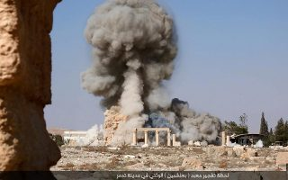 An undated image, which appears to be a screenshot from a video and which was published by the Islamic State group in the Homs province (Welayat Homs) on August 25, 2015, allegedly shows smoke billowing from the Baal Shamin temple in Syria's ancient city of Palmyra. The temple was reportedly destroyed by the extremist group and news of its demolition sparked international condemnation earlier this week. AFP PHOTO / HO / WELAYAT HOMS 