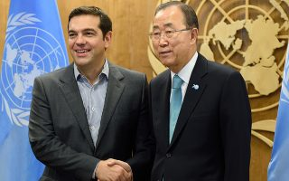 Greece Prime Minister Alexis Tsipras (L) shakes hands with UN Secretary General Ban Ki-moon before their meeting during the 70th session of the United Nations General Assembly September 29, 2015 in New York. AFP PHOTO/DON EMMERT