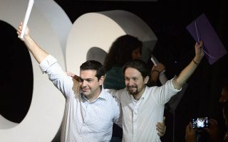(FILES) A picture taken on November 15, 2014 shows President of Greek oposition SYRIZA (Coalition of the Radical Left) Alexis Tsipras (L) and newly confirmed leader of Podemos, a left-wing party that emerged out of the