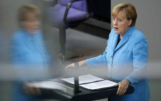 German Chancellor Angela Merkel delivers a speech as part of a meeting of the German Federal Parliament, Bundestag, at the Reichstag building in Berlin, Germany, Wednesday, Sept. 9, 2015. (AP Photo/Michael Sohn)