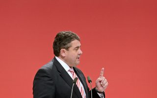 German Social Democratic Party, SPD, Chairman Sigmar Gabriel delivers his keynote speech at the party's convention in Leipzig, Germany, Thursday, Nov. 14, 2013. Following the Sept. 22 national elections the Social Democrats are negotiating the fourth week with Chancellor Angela Merkel's Christian bloc on forming a new coalition government. The word reads: 'Party Convention'. (AP Photo/Jens Meyer)
