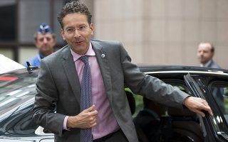 epa04844105 President of Eurogroup Jeroen Dijsselbloem arrives for a Eurozone leaders' summit on the Greek crisis in Brussels, Belgium, 12 July 2015. Eurozone finance ministers have made progress in their crisis talks on Greece, but are now calling on their countries' leaders to resolve the remaining issues. Greece is teetering on the edge of default, cut off from bailout aid, in arrears to the International Monetary Fund (IMF), owing large debt repayments this month and fending off suggestions that it could soon exit the eurozone.  EPA/LAURENT DUBRULE