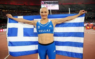 epa04899181 Greece's Nikoleta Kyriakopoulou celebrates after winning the bronze medal in the women's Pole Vault final of the Beijing 2015 IAAF World Championships at the National Stadium, also known as Bird's Nest, in Beijing, China, 26 August 2015.  EPA/DIEGO AZUBEL
