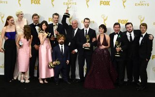 epa04942036 The cast and crew of 'Game of Thrones' pose with their awards including Outstanding Drama Series in the press room during the 67th annual Primetime Emmy Awards held at the Microsoft Theater in Los Angeles, California, USA, 20 September 2015. 'Game of Thrones' won record breaking 12 Emmys. The Primetime Emmy Awards celebrate excellence in national primetime television programming.  EPA/PAUL BUCK