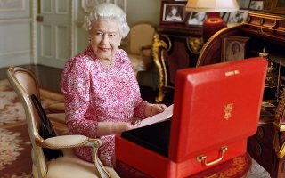 epa04921069 This handout picture of Queen Elizabeth II taken in July 2015 has been released by Buckingham Palace on 08 September 2015 to mark the moment she becomes the longest reigning British Monarch. The photograph, by British photographer Mary McCartney, shows The Queen seated at her desk in her private audience room at Buckingham Palace in London, Britain, with one of her official red boxes which she has received almost every day of her reign and contain important papers from government ministers in the United Kingdom and her Realms and from her representatives across the Commonwealth and beyond.  EPA/Mary McCartney / Her Majesty Queen Elizabeth II / HANDOUT ATTENTION EDITORS : This image is free of charge for a month from release. Use or reproduction in any format on any platform after October 8, 2015, must be approved first by Royal Communications at Buckingham Palace. MADATORY CREDIT: Mary McCartney HANDOUT EDITORIAL USE ONLY/NO SALES