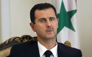 FILE - This Aug. 19, 2009 file photo shows Syrian President Bashar Assad during a meeting with his Iranian counterpart Mahmoud Ahmadinejad in Tehran, Iran. Speaking in an interview with Russian media, Tuesday, Sept. 15, 2015, Assad said the refugee crisis now hitting Europe is a direct result of the West's support of