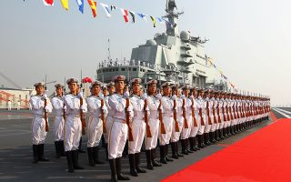 Naval honour guards stand as they wait for a review on China's aircraft carrier