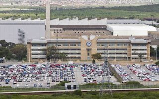 A photo taken on October 1, 2015 shows a general view of the Volkswagen car production plant in Uitenhage, on the outskirts of Port Elizabeth, South Africa. Embattled auto giant Volkswagen said on October 1 that an investigation it has commissioned into its massive pollution cheating scandal would take several months, as Australia became the latest country to warn the company it could face huge fines. AFP PHOTO / MICHAEL SHEEHAN
