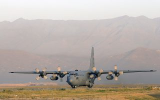 (FILES) This file picture taken on August 19, 2012 shows a Lockheed C 130 Hercules of the US Air Force landing at the Kabul International airport, in Kabul. Eleven people, including six US troops, were killed when a C-130 military transport plane crashed on October 2, 2015 in Jalalabad in eastern Afghanistan, an official said.    AFP PHOTO / FILES / ALEXANDER KLEIN