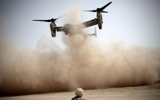 (FILES) In this picture taken on March 22, 2010, a US Marines V-22 Osprey tiltrotor aircraft kicks up dust as it takes off inside a US Marines base of 3rd Battalion, 6th Marines in Marjah.  A US aircraft crashed in Afghanistan, killing three American troops and a civilian in the south where a nearly nine-year Taliban insurgency has been concentrated, the military said April 9, 2010. The cause of the incident that downed the US Air Force CV-22 Osprey, which takes off like a helicopter but flies more like a plane, was under investigation, said the US-run International Security Assistance Force (ISAF).AFP PHOTO/Mauricio LIMA/FILES