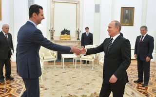 In this photo taken on Tuesday, Oct. 20, 2015, Russian President Vladimir Putin, right, shakes hand with Syrian President Bashar Assad in the Kremlin in Moscow, Russia.  Assad was in Moscow, in his first known trip abroad since the war broke out in Syria in 2011, to meet his strongest ally Russian leader Vladimir Putin. The two leaders stressed that the military operations in Syria_ in which Moscow is the latest and most powerful addition_ must lead to a political process. (Alexei Druzhinin, RIA-Novosti, Kremlin Pool Photo via AP)