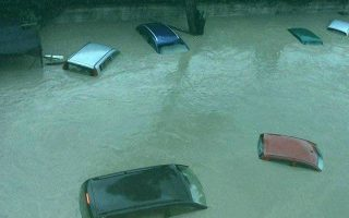 epa04978012 A photo provided by the Italian Fire Fighters Press Office of vehicles submerged in flood water from the Calore River in Benevento, southern Italy 2015. The river burst its banks following torrential rainfall in the area  EPA/FIRE FIGHTERS PRESS OFFICE  HANDOUT EDITORIAL USE ONLY/NO SALES