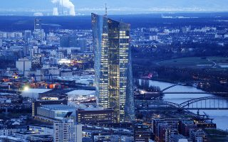 The new headquarters of the European Central Bank is photographed in Frankfurt, Germany, Wednesday, Jan. 14, 2015. A legal opinion issued Wednesday by an adviser to the European Union's top court helps clear the way for bigger stimulus measures from the European Central Bank, analysts said. The opinion from Pedro Cruz Villalon, an advocate general with the European Court of Justice, said that the ECB's offer in 2012 to buy government bonds of troubled countries was legal in principle.  (AP Photo/Michael Probst)