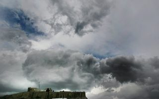 Clouds are seen over the Parthenon on Acropolis Hills in Athens, Greece, on 06 February 2012. Prime minister Lucas Papademos will resume tough negotiations with the European Commission (EC), European Central Bank (ECB) and International Monetary Fund (IMF) 'troika' leaders on Monday to finalise the agreement on a second EU/IMF bailout loan to Greece. EPA/SIMELA PANTZARTZI EPA/ANA-MPA/SIMELA PANTZARTZI
