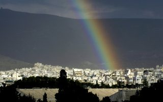 A rainbow arches over the refurbished ancient Panathenaean marble stadium, foreground, in Athens, Greece, after rain on Friday, March 24 2006. The narrow horseshoe stadium hosted the first modern Olympics in 1896, and the archery event and marathon finish in the Athens 2004 Games. (AP Photo/Petros Giannakouris)
