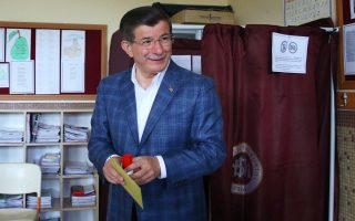 epa04787701 A handout picture provided by the Press Office of the Turkish Prime Minister shows the Turkish Prime Minister, Ahmet Davutoglu, casting his vote at a polling station in Konya, Turkey on 07 June 2015. According to reports some 53 million Turkish people are elligible to vote in the general elections on 07 June 2015 for the 550-seat parliament, with some sources adding that the Kurdish vote, could be crucial in terms of the ruling AKP's ability to maintain the supermajority it requires to effect consitutional change allocating more powers to the President, a post currently occupied by former Prime Minister, Erdogan.  EPA/PRIME MINISTER PRESS OFFICE / HANDOUT  HANDOUT EDITORIAL USE ONLY/NO SALES