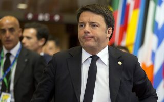 Italian Prime Minister Matteo Renzi, right, leaves after an EU summit in Brussels early Friday, Oct. 16, 2015. European Union heads of state met Thursday to discuss, among other issues, the current migration crisis. (AP Photo/Virginia Mayo)