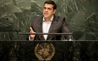 Alexis Tsipras, Prime Minister of Greece addresses a plenary meeting of the United Nations Sustainable Development Summit 2015 at the United Nations headquarters in Manhattan, New York September 27, 2015. More than 150 world leaders are expected to attend the three day summit to formally adopt an ambitious new sustainable development agenda, according to a U.N. press statement. REUTERS/Mike Segar