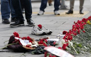 epa04974671 People place flowers and shoes on the ground after a twin bombing in Ankara Turkey, 12 October 2015. Mourners anxiously began to gather in Ankara 11 October to commemorate the 95 people killed in twin blasts the previous day at a pro-Kurdish peace rally, the worst attack in Turkey's modern history. No group claimed responsibility for the attack, which came three weeks before snap general elections set for 01 November and the G20 heads-of-government summit later next month, raising security concerns.  EPA/SEDAT SUNA