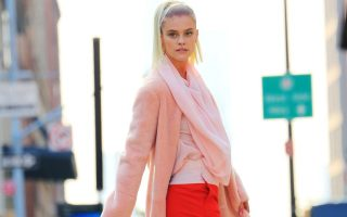 Nina Agdal does a photoshoot in red and pink with a male model in the streets of NYC<P><noscript><img width=