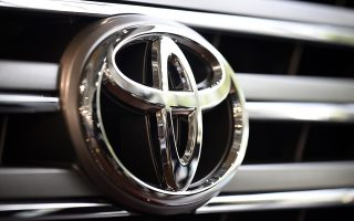 epa04986269 (FILE) A file picture dated 04 August 2015 shows the Toyota Motor Corp. logo seen on a vehicle displayed at the company's showroom in Tokyo, Japan. Toyota Motor Corp said on 21 October 2015 it is recalling 6.5 million vehicles worldwide over faulty power-window switch. The recalls include about 2.7 million units in North America, 1.2 million in Europe and 600,000 in Japan, Toyota said. According to reports Toyota was not aware of any accidents caused by the glitch, but the carmaker has received one incident report from the US market indicating the customer received a burn on the hand. The Japanese carmaker said modules in power window master switches may have been lubricated with a sprayed-on grease inconsistently during manufacturing process. Debris caused by wear from the electrical contact points can accumulate and cause a short circuit. That could lead the switch assembly to overheat and melt, potentially leading to a fire, the carmaker said.  EPA/FRANCK ROBICHON