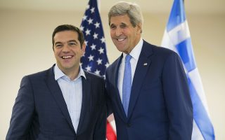 US Secretary of State John Kerry (R) and Greek Prime Minister Alexis Tsipras pose for the media at the United Nations headquarters in New York on September 30, 2015. AFP PHOTO/Dominick Reuter