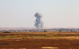 (FILES) - A file picture taken on September 1, 2015 shows smoke billowing on the outskirts of Marea, in Syria's northern Aleppo district, during fighting between opposition fighters and Islamic State (IS) group jihadists. A source from the Organisation for the Prohibition of Chemical Weapons (OPCW) declared on November 5, 2015 that mustard gas was used during summer fighting in Syria, but it was not clear by whom, in the flashpoint town of Marea. AFP PHOTO / ZAKARIYA AL-KAFI