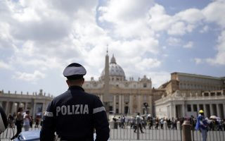 A police officer patrols outside St. Peter's Square, in Rome Friday, April 24, 2015. Islamic extremists suspected in a bomb attack in a Pakistani market that killed more than 100 people had also planned an attack against the Vatican in 2010 that was never carried out, an Italian prosecutor said Friday. Wiretaps collected as part of investigation into an Islamic terror network operating in Italy gave