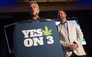 Jimmy Gould, co-founder of Responsible Ohio, a pro-marijuana legalization group, speaks to the crowd after a concession speech delivered by executive director Ian James, right, at an election night event at the Le Meridien hotel, Tuesday, Nov. 3, 2015, in Columbus, Ohio. Voters have rejected a ballot measure that would have made Ohio the first state to make marijuana legal for both recreational and medical use in a single stroke. (AP Photo/John Minchillo)