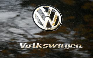 The VW logo is pictured on the back of a vintage Volkswagen car at a car shop in Bad Honnef near Bonn, Germany, November 4, 2015. Investors wiped another 3 billion euros off Volkswagen's market value on Wednesday after it said it had understated the fuel consumption of some cars, opening a new front in a scandal that initially centred on rigging emissions tests. REUTERS/Wolfgang Rattay