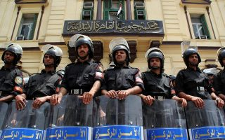 CAPTION CORRECTION - CORRECTING YEAREgyptian riot policemen stand in line during a protest in Cairo May 7, 2006.  Egyptian police detained 10 pro-reform activists on Sunday, after beating a small group of up to 30 people taking part in a protest against previous detentions of demonstrators, activists said. REUTERS/Egypt Stringer