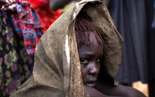 A Pokot girl cries after being circumcised in a village about 80 kilometres from the town of Marigat in Baringo County, October 16, 2014. The traditional practice of circumcision within the Pokot tribe is a rite of passage that marks the transition to womanhood and is a requirement for all girls before they marry. More than a quarter of girls and women in Kenya have undergone genital cutting, according to United Nations data. Despite a government ban on the life-threatening practice since 2011, the long-standing tradition remains a rite of passage, particularly among poor families in rural areas. Picture taken October 16, 2014.     REUTERS/Siegfried Modola (KENYA - Tags: SOCIETY TPX IMAGES OF THE DAY)ATTENTION EDITORS: PICTURE 14 OF 26 PICTURES FOR WIDER IMAGE STORY 'TRADITION DEFIES LAW'SEARCH 'MODOLA TRADITION' FOR ALL IMAGES