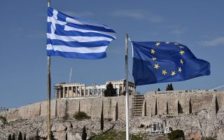 The Greek and EU flags flutter in front of the ancient Acropolis hill in Athens on January 15, 2014. Before snap elections were unexpectedly called in Greece on January 25, the troubled country was expected to finally limp out of recession after six painful years in the red. Now, with a clear electoral result far from certain, Greece's long-suffering business community fears that any chance of a tentative recovery will be delayed -- if not killed off outright -- by a damaging political stalemate.  AFP PHOTO / LOUISA GOULIAMAKI