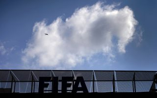 (FILES) This file picture taken on May 27, 2015 shows a cloud the headquarters of international football's top body FIFA in Zurich. Swiss authorities arrested several football officials in a fresh wave of dawn raids early on December 3, 2015 in a dramatic widening of the FIFA corruption scandal, the New York Times reported.  AFP PHOTO / FILES / FABRICE COFFRINI