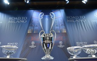 The UEFA Champions league trophy is displayed ahead of the draw for the UEFA Champions league round of sixteen, on December 14, 2015 at the European football organization's headquarters in Nyon.  AFP PHOTO / FABRICE COFFRINI