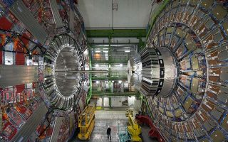 TO GO WITH AFP STORY BY MARIETTE LE ROUX  A picture taken on February 10, 2015  in Meyrin, near Geneva, shows the CMS (Compact Muon Solenoid) Cavern at the European Organisation for Nuclear Research (CERN). Excitement is mounting at the world's largest proton smasher, where scientists are close to launching a superpowered hunt for particles that may change our understanding of the Universe. Physicists and engineers are running the final checks on an upgrade that nearly doubled the muscle of the Large Hadron Collider (LHC), which in 2012 unlocked the putative Higgs boson and, with it, a Nobel Prize. The two-year power boost will take experiments into a previously-inaccessible realm that resembles science fiction.         AFP PHOTO / RICHARD JUILLIART