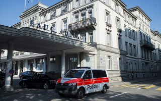 epa04769568 A police car parks in front of the five-star hotel Baur au Lac in Zurich, Switzerland, Wednesday morning, 27 May 2015. Swiss authorities, at the behest of the U.S. Justice Department and FBI, carried out early morning raids at the luxury hotel, arresting several prominent FIFA officials on federal charges of corruption with plans to extradite them to the U.S. The New York Times reports that more than a dozen plain-clothed officers descended on the five-star Baur au Lac hotel in the Swiss city early on Wednesday morning local time. Early reports indicate that up to a dozen or more FIFA officials have been arrested at the hotel, although Swiss authorities have so far only confirmed six arrests.  EPA/ENNIO LEANZA