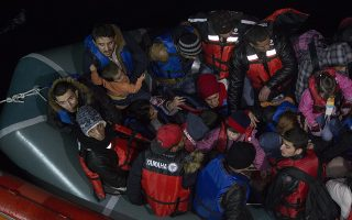 epa05062934 A picture made avaliable on 10 December 2015 shows members of Turkish Coastal Guard ship UMUT bring some Syrian refugees on a boat after they attempted to reach Greek Island Chios at the Agean Sea in Cesme district near Izmir, coastal city of Turkey, 09 December 2015. The migrants, mostly from Iran, Bangladesh, Pakistan and Morocco, were placed on buses, some forcibly, and transported to shelters in Athens 550 kilometres to the south, reports said. Around 1,200 people had been stranded at the border since Macedonia started denying entry to so-called economic migrants trying to reach Western Europe via the Balkan route, which stretches from Turkey, through Greece, Macedonia, Serbia, Croatia, Slovenia and finally to Austria. In Athens, they will have to apply for asylum or be repatriated. Greek police sealed Idomeni on 09 December morning, also blocking access to reporters and humanitarian workers.  EPA/TOLGA BOZOGLU