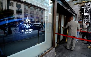 epa05100541 (FILE) A file photo dated 20 August 2013 shows a person entering the Al Jazeera America television broadcast studio on West 34th Street in New York City, New York, USA. Al Jazeera America, the US cable news channel of the Qatar-based Al Jazeera television network, will terminate all news operations at the end of April 2016 after just over two and a half years on air, the company's chief executive announced on 13 January 2016.  EPA/PETER FOLEY