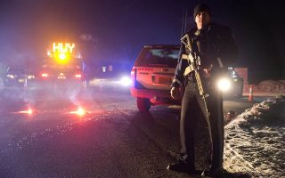 Sgt. Tom Hutchison stands in front of an Oregon State Police roadblock on Highway 395 between John Day and Burns by Oregon State police officers Tuesday, Jan. 26, 2016. Authorities say shots were fired Tuesday during the arrest of members of an armed group that has occupied a national wildlife refuge in Oregon for more than three weeks. The FBI said authorities arrested Ammon Bundy, 40, his brother Ryan Bundy, 43, Brian Cavalier, 44, Shawna Cox, 59, and Ryan Payne, 32, during a traffic stop on U.S. Highway 395 Tuesday afternoon. Authorities said another person, Joseph Donald O'Shaughnessy, 45, was arrested in Burns. In a statement, the FBI said one individual