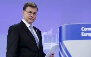 epa05020396 European commission Vice-President in charge of the Euro and Social Dialogue Valdis Dombrovskis during a news conference at the EU Commission headquarters in Brussels, Belgium,  11 November 2015. The European Commission held a debate about the next steps needed to complete the Banking Union, and achieving a full and deep Economic and Monetary Union (EMU), and in particular to bring forward a proposal for a European Deposit Insurance Scheme.  EPA/OLIVIER HOSLET